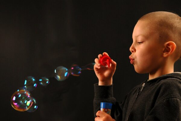Young boy blowing bubbles All Behaviour Consultancy webinar