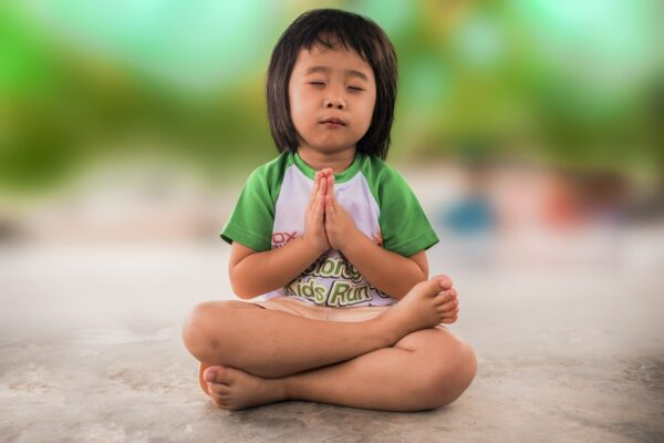 Young girl sitting and praying All Behaviour Consultancy webinar
